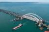Путин на КамАЗе первым проехал по Крымскому мосту